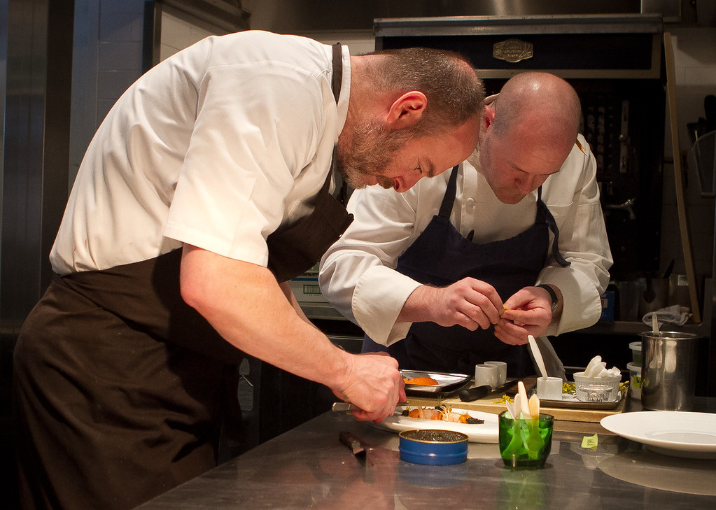 Chef Michael Tusk and Chef de Cuisine Tim Caspare create a dish at Quince Restaurant in San Francisco, Calif., on Thursday April 6th, 2012.