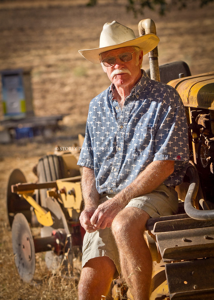 Randy Dunn sits on an old tractor at his home in Angwin, Calif.,  on Thursday, August 16th, 2012.