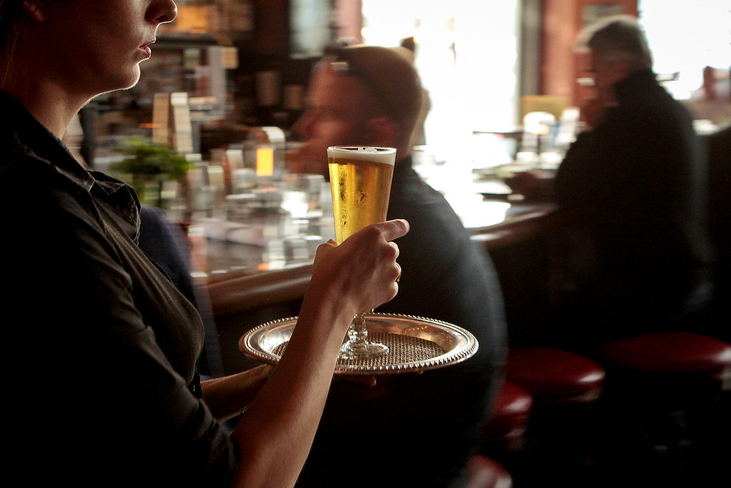 A server takes a beer to a table at Revival Bar & Restaurant in Berkeley, Calif., on Wednesday, July 25th, 2012.
