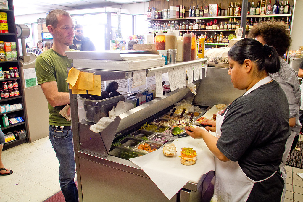Iliana Ayala makes the Korean Steak sandwich at Rhea's Deli in San Francisco, Calif.,  on Wednesday,  June 6th, 2012.
