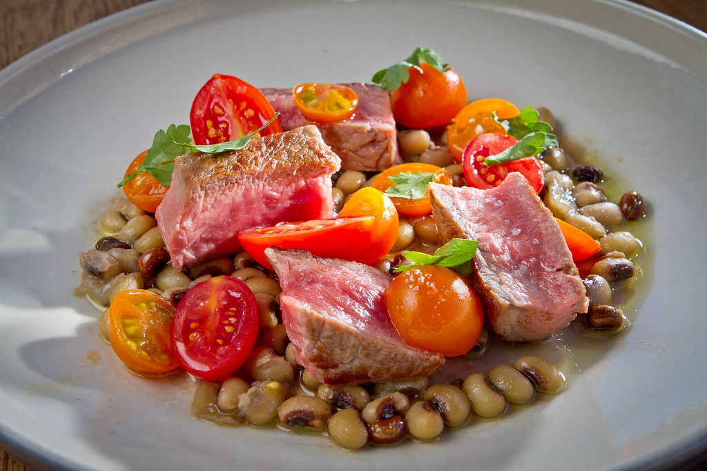 The New York Steak with Sungold Tomatoes and Black Eye Peas at Rich Table in San Francisco is seen on Wednesday, September 19th, 2012.