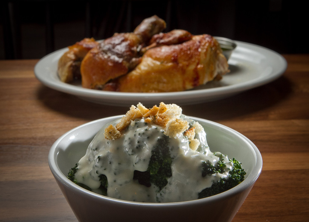 Broccoli with Cheese Sauce and the half rotisserie Chicken at Roostertail Restaurant in San Francisco Calif., is seen on Thursday, March 1st, 2012.