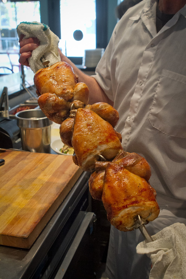 Chickens being pulled off the rotisserie at Roostertail Restaurant in San Francisco Calif., on Thursday, March 1st, 2012.
