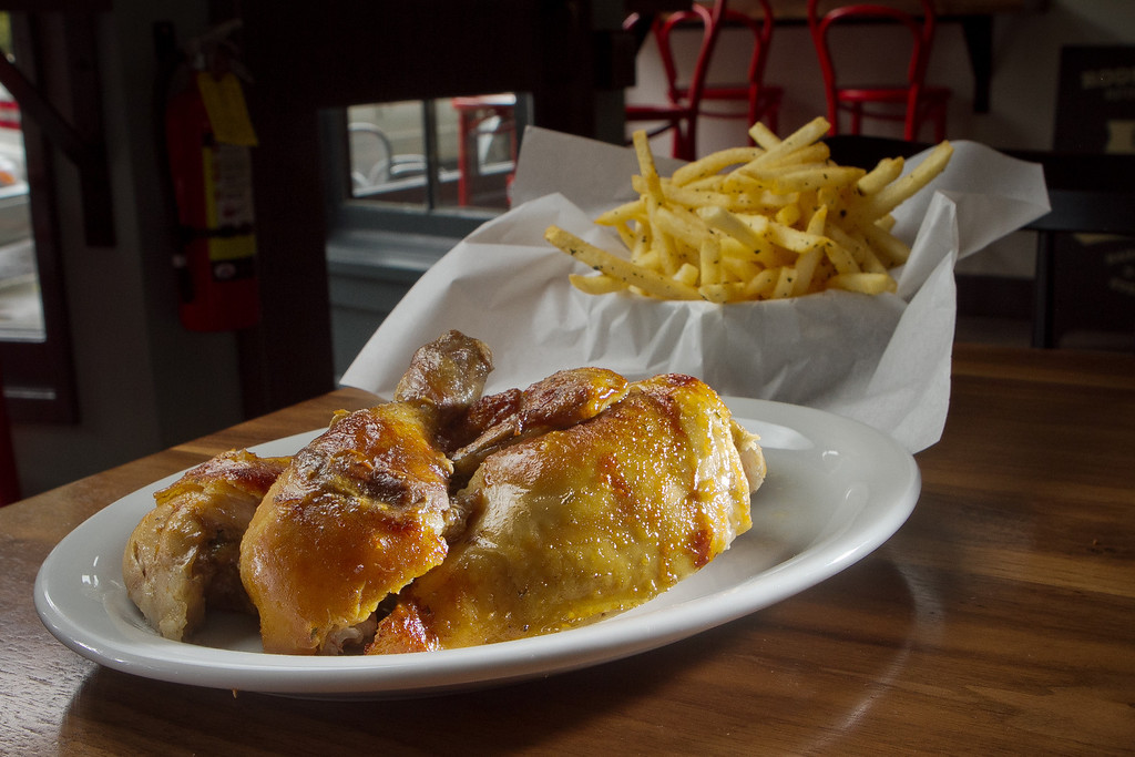 The half rotisserie chicken with fires on the side at Roostertail Restaurant in San Francisco Calif., is seen on Thursday, March 1st, 2012.