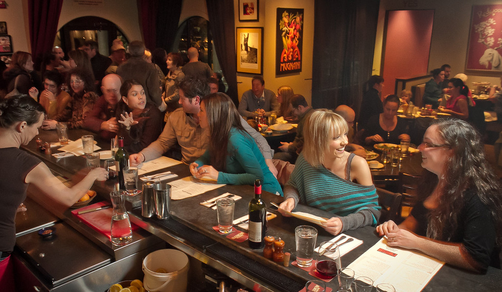 Customers enjoy dinner and drinks at Rosso Pizzeria in Santa Rosa, Calif., on Saturday, February 18th, 2012.
