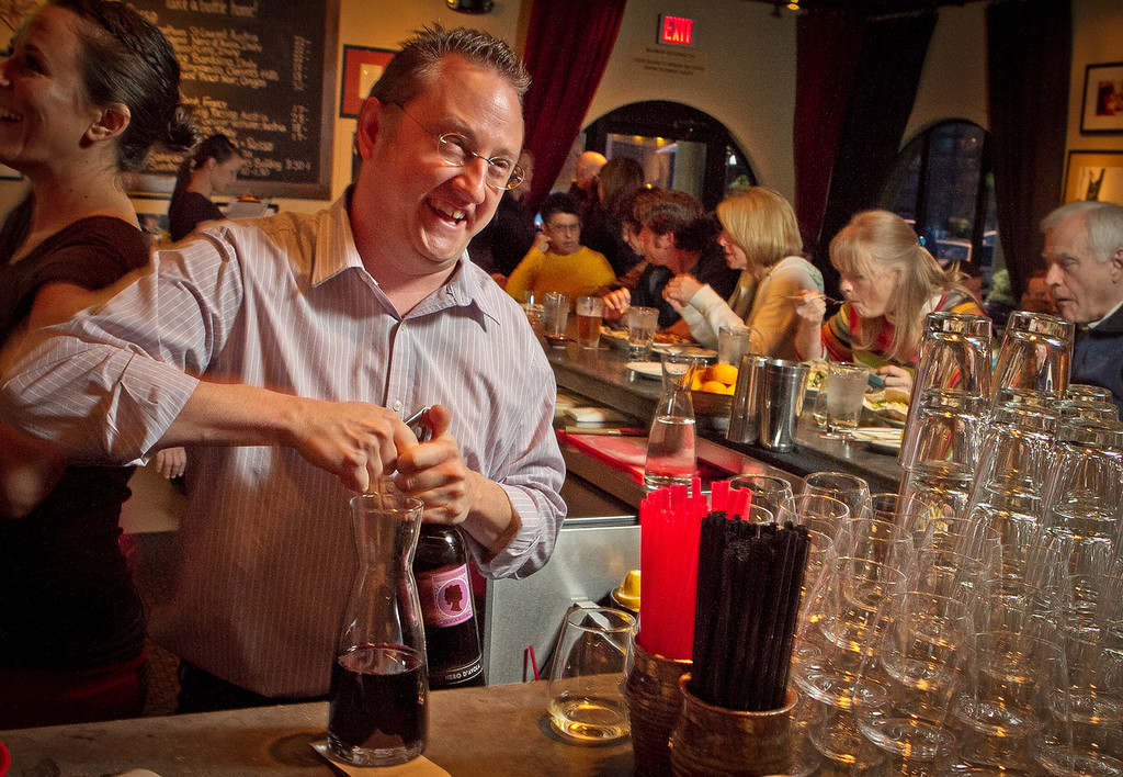 Bar Director Rich Houden opens at wine at Rosso Pizzeria in Santa Rosa, Calif., on Saturday, February 18th, 2012.
