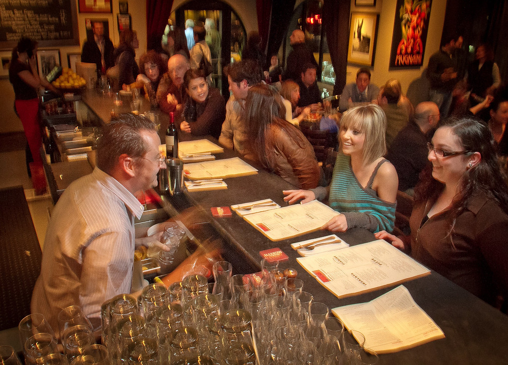 Bar Director Rich Houden talks with guests at Rosso Pizzeria in Santa Rosa, Calif., on Saturday, February 18th, 2012.