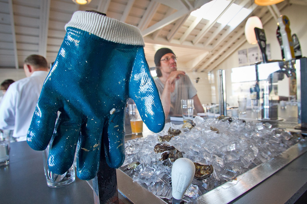 A glove for shucking rests on the oyster bar at Saltwater Oyster Depot in Inverness, Calif., on Friday, September 8th, 2012.