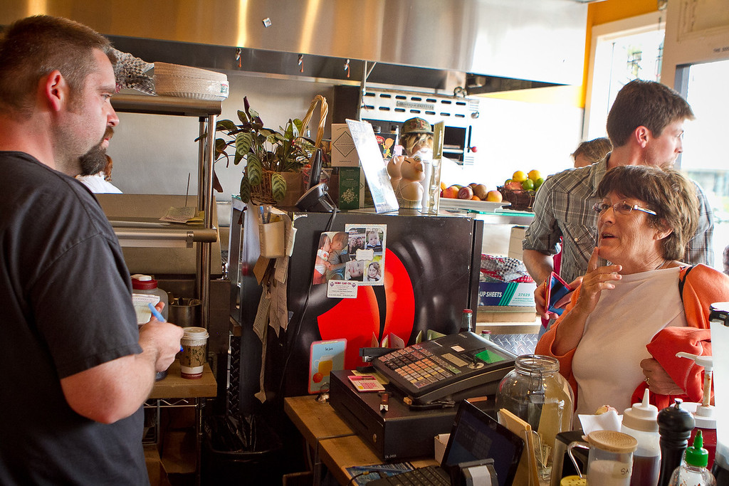 Chef/owner Michael Boyd  takes orders for lunch at Scolari's Good Eats  in Alameda, Calif., on Friday, June 29th, 2012.