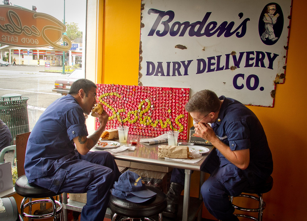 Two Coast Guard seamen eat lunch at Scolari's Good Eats  in Alameda, Calif., on Friday, June 29th, 2012.