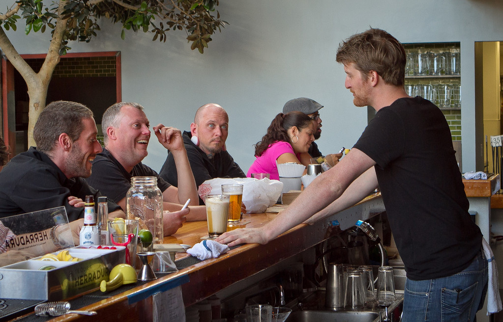 Bartender Clayton Mannix talks with customers during happy hour at the Southern Pacific Brewing Company in San Francisco, Calif., on Wednesday, June 13th, 2012.