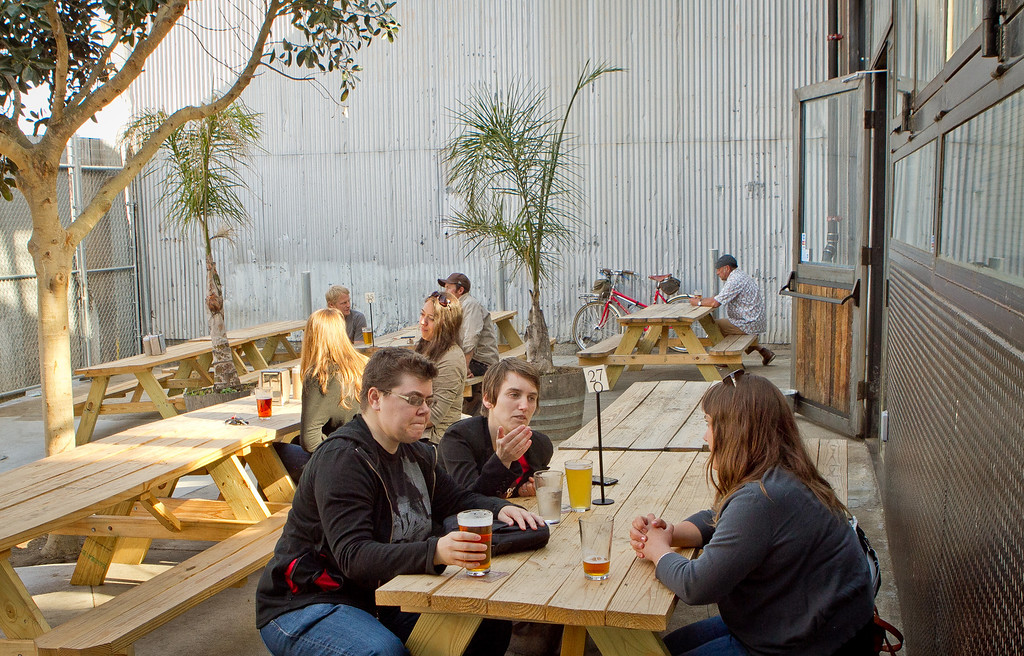 People enjoy the outdoor patio at the Southern Pacific Brewing Company in San Francisco, Calif., on Wednesday, June 13th, 2012.