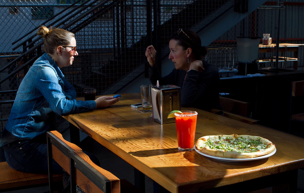 """The Green Garlic Asparagus Pizza with the """"Ballon Juice"""" drink at  Southern Pacific Brewing Company in San Francisco, Calif., is seen on Wednesday, June 13th, 2012."""