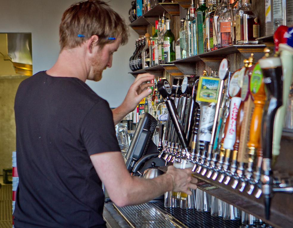 Bartender Clayton Mannix pours a beer at the Southern Pacific Brewing Company in San Francisco, Calif., on Wednesday, June 13th, 2012.