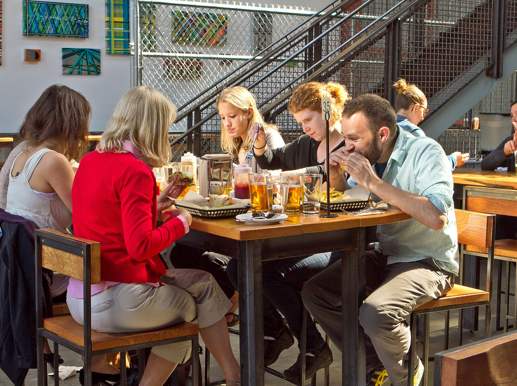People enjoy happy hour at the Southern Pacific Brewing Company in San Francisco, Calif., on Wednesday, June 13th, 2012.