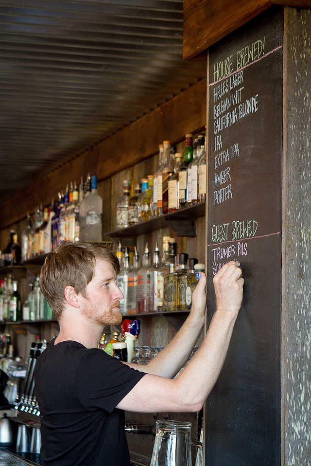 Bartender Clayton Mannix writes the beer selection on the board at Southern Pacific Brewing Company in San Francisco, Calif., on Wednesday, June 13th, 2012.