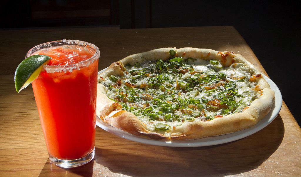 "The Green Garlic Asparagus Pizza with the ""Ballon Juice"" drink at  Southern Pacific Brewing Company in San Francisco, Calif., is seen on Wednesday, June 13th, 2012."