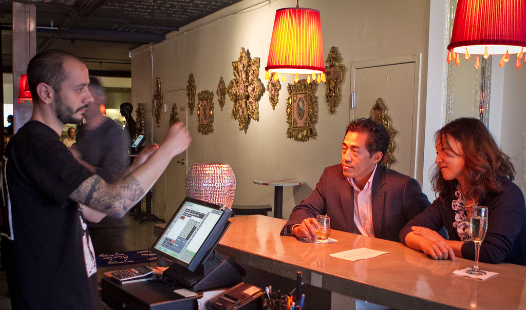 Bartender Luca Martini talks with customers in the bar at Specchio Restaurant in San Francisco , Calif., on Thursday, May 3rd, 2012.
