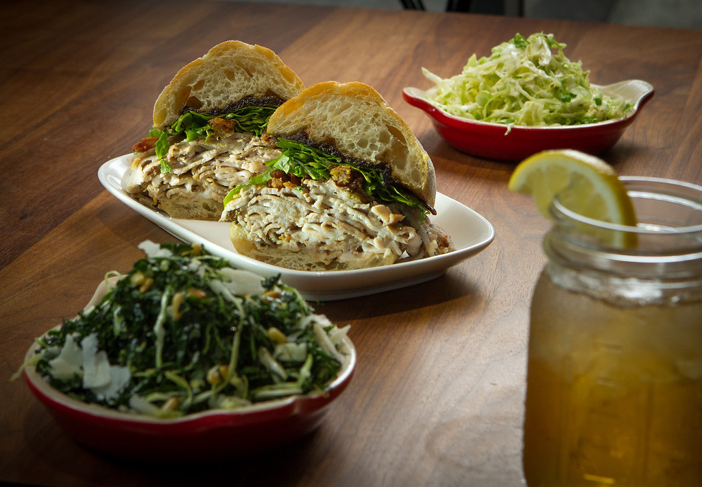 The Rotisserie Porchetta with sides of Cole Slaw, rear, and Kale Salad at Split Bread in San Francisco, Calif., are seen on Friday, November 30th, 2012.