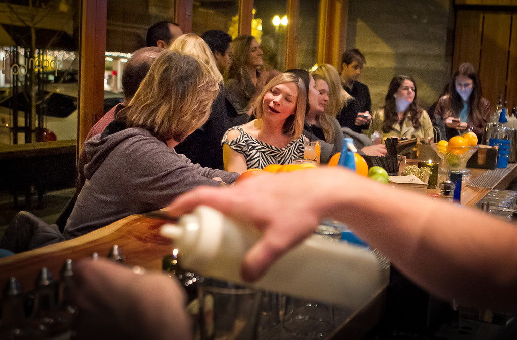 People enjoy the bar during Happy Hour at the Spoon Bar in Healdsburg, Calif., on Saturday, January 7th,  2012.