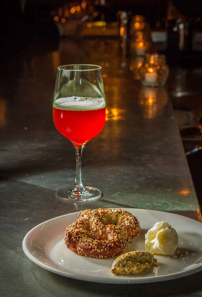 """The Soft Pretzel with a """"Plum Sour"""" Ale from the Pasadena Brewing Company at St. Vincent restaurant in San Francisco, Calif., is seen on Friday, December 7th, 2012."""