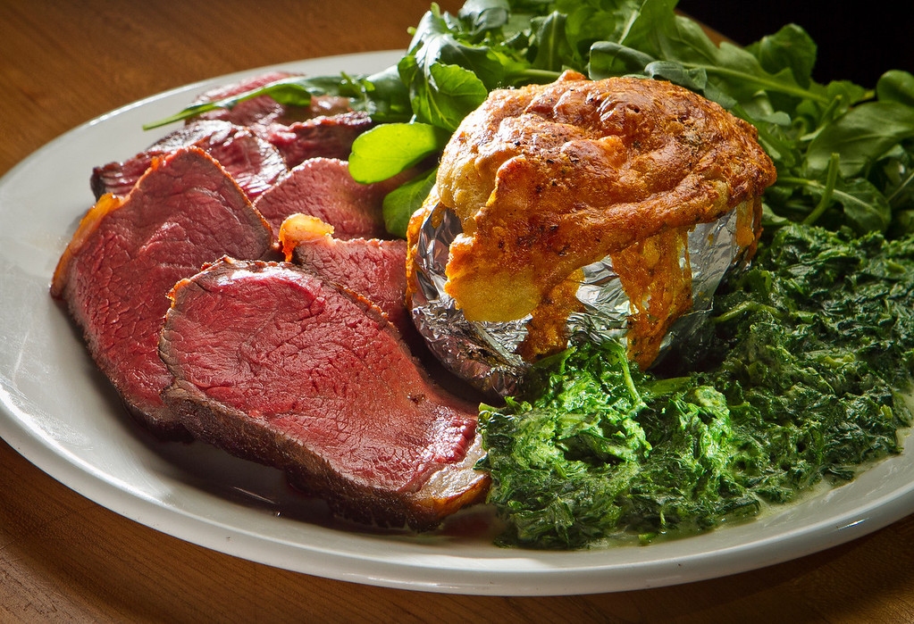The Dry-Aged Sirloin with Nettles and a baked potato at St. Vincent restaurant in San Francisco, Calif., is seen on Thursday, July 12th, 2012.