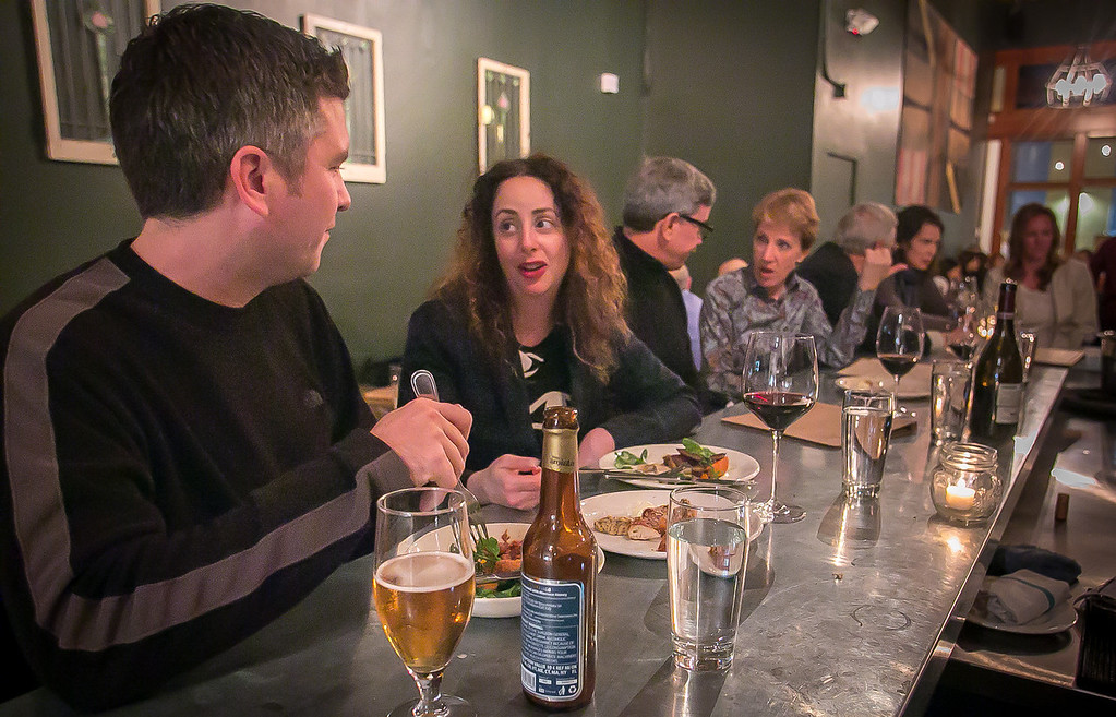 People enjoy dinner and drinks at the bar at St. Vincent restaurant in San Francisco, Calif., on Friday, December 7th, 2012.