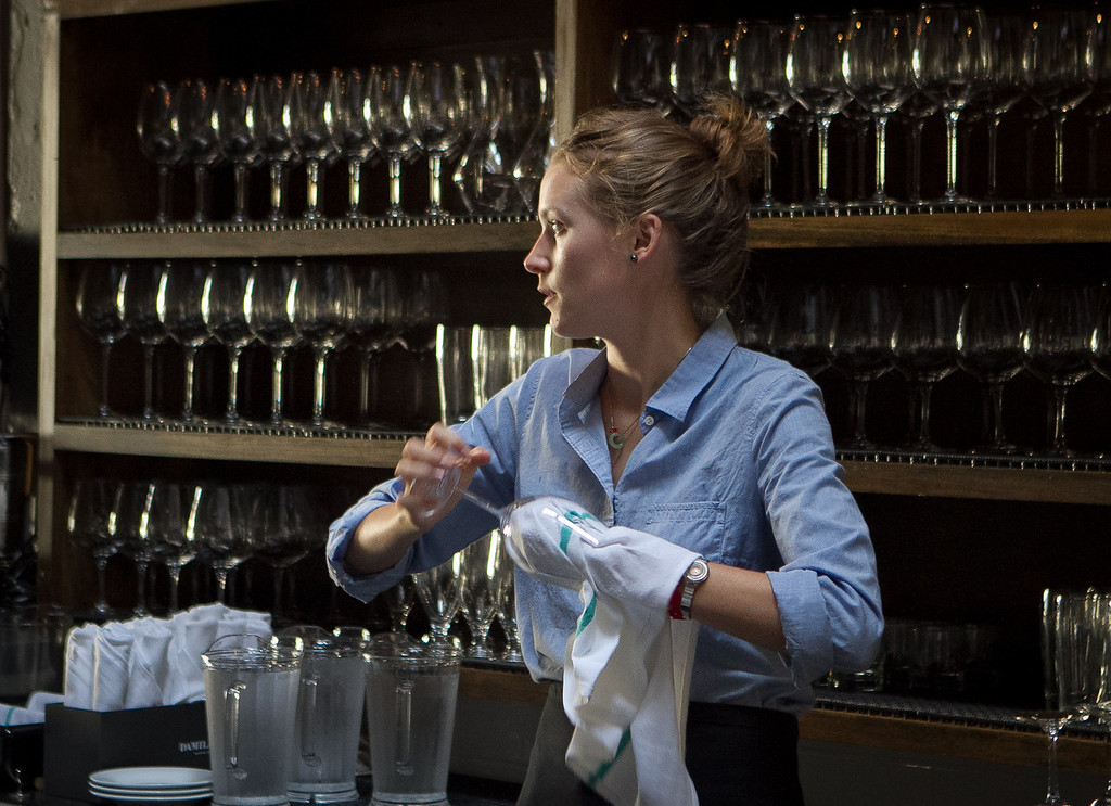 Holly Wickham cleans glasses at St. Vincent restaurant in San Francisco, Calif., on Thursday, July 12th, 2012.