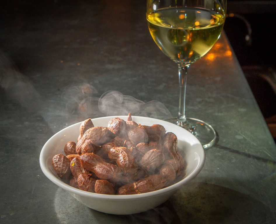 The Boiled Peanuts with a glass of 2009 Mogl Riesling Federspiel at St. Vincent restaurant in San Francisco, Calif., is seen on Friday, December 7th, 2012.
