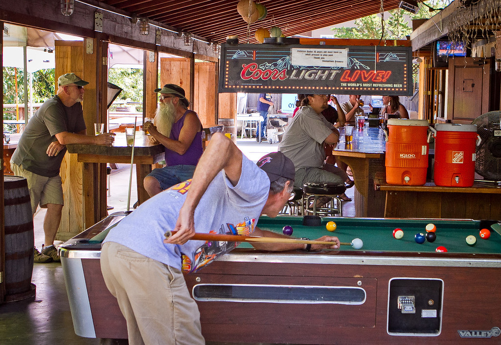 Pool being played during happy hour at  Stumptown Brewery in Guerneville, Calif., on Friday, July 13th, 2012.