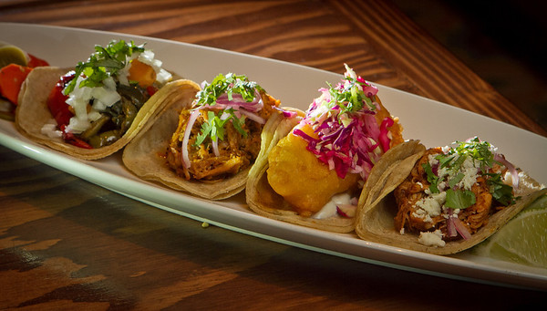 Tacos from left to right; Butternut Squash, Cochinita Pibil, Rock Cod, and Chicken en Mole Colorado at Tacolicious in San Francisco Calif., is seen on Monday, March 5th, 2012.