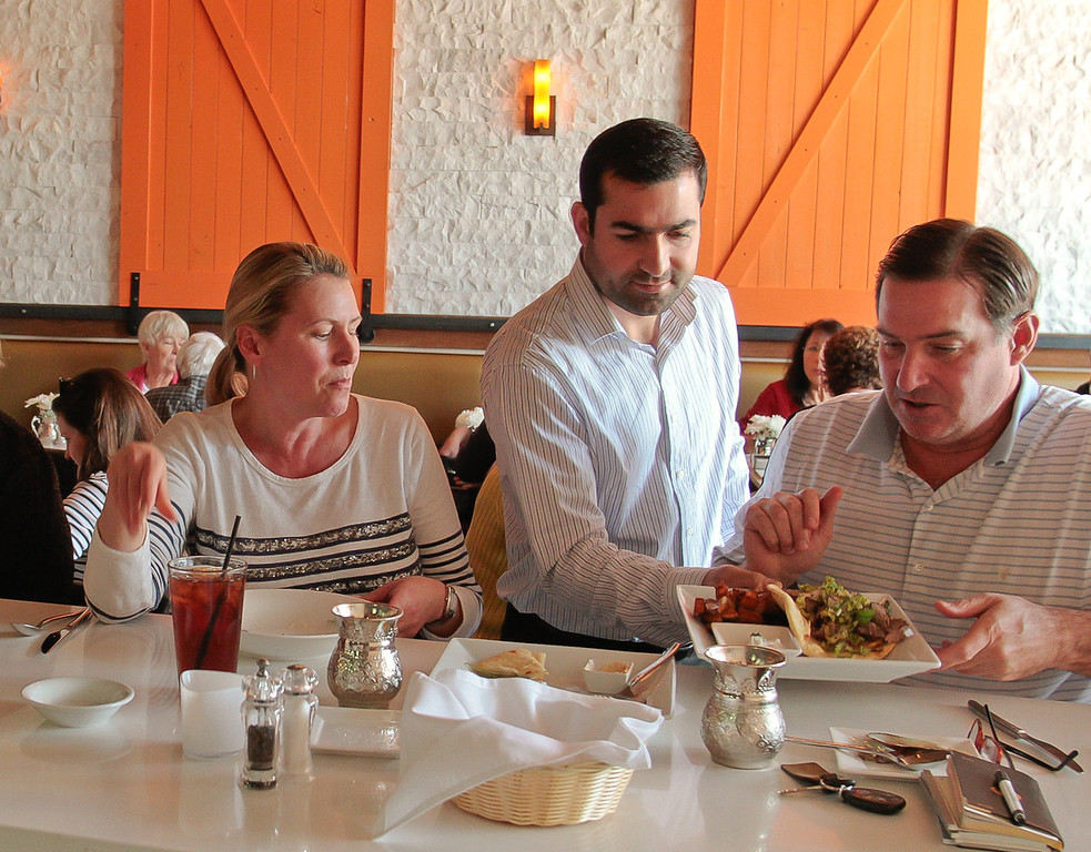 Owner Yusuf Topal serves customers lunch at Tarla Mediterranean Grill in Napa,  Calif., on Friday, March 9th, 2012.
