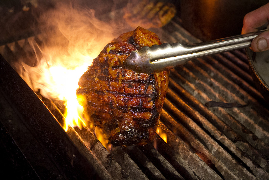 The Pork Chop being grilled at the Tee Off Bar & Grill in San Francisco, Calif., is seen on Saturday, June 9th, 2012.