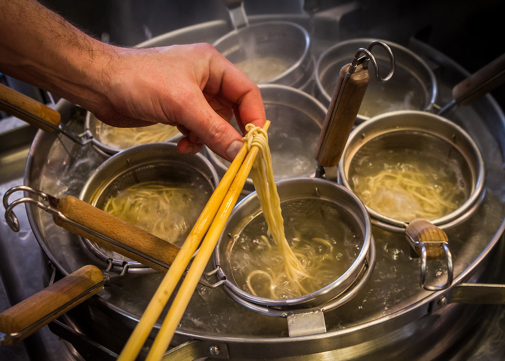 Chef Jerry Jaksich pulls a noodle to check the Ramen for doneness at the  Ramen Shop in Oakland, Calif. on Friday, February 15th, 2013.