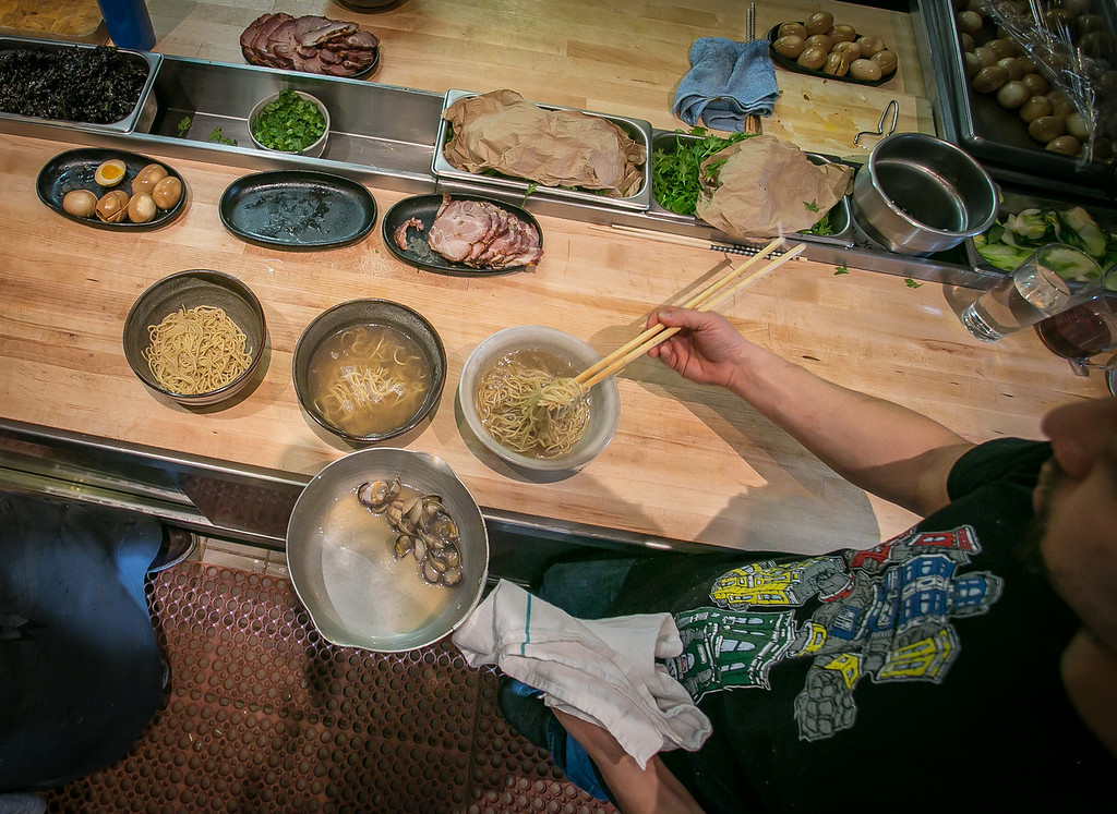 Rayneil De Guzman prepares a bowl of Ramen at the Ramen Shop in Oakland, Calif. on Friday, February 15th, 2013.