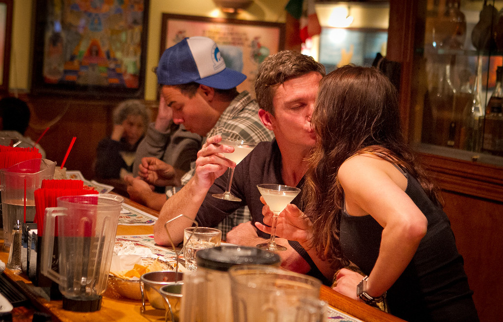 A couple enjoy Margaritas at Tommy's Mexican Restaurant in San Francisco, Calif., on Monday April 23rd, 2012.