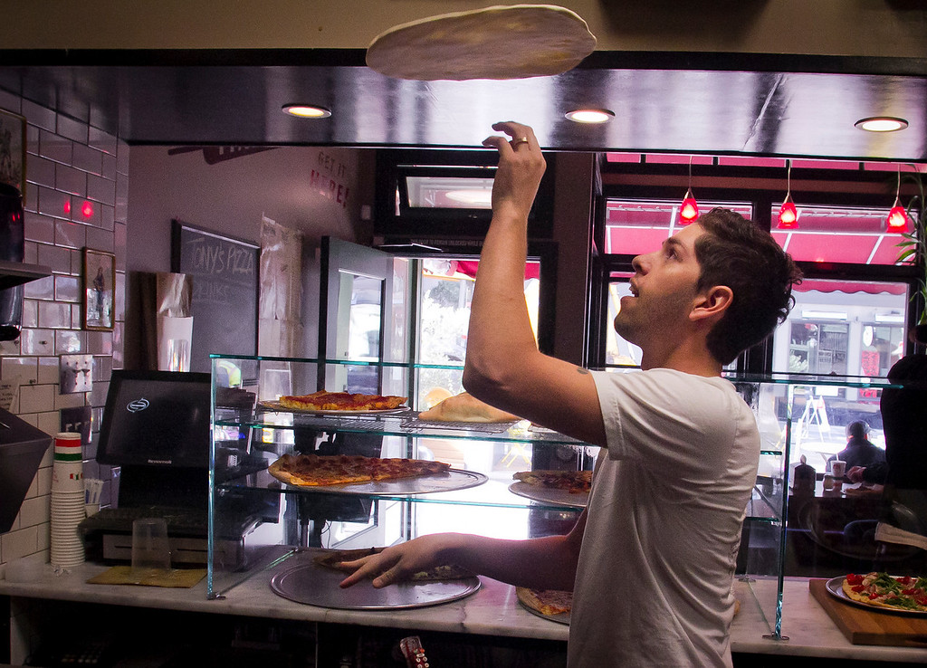 General manager Eric Cocbin tosses a pie at Tony's Coal-Fired Pizza in San Francisco, Calif., on Monday, December 5th,  2011.