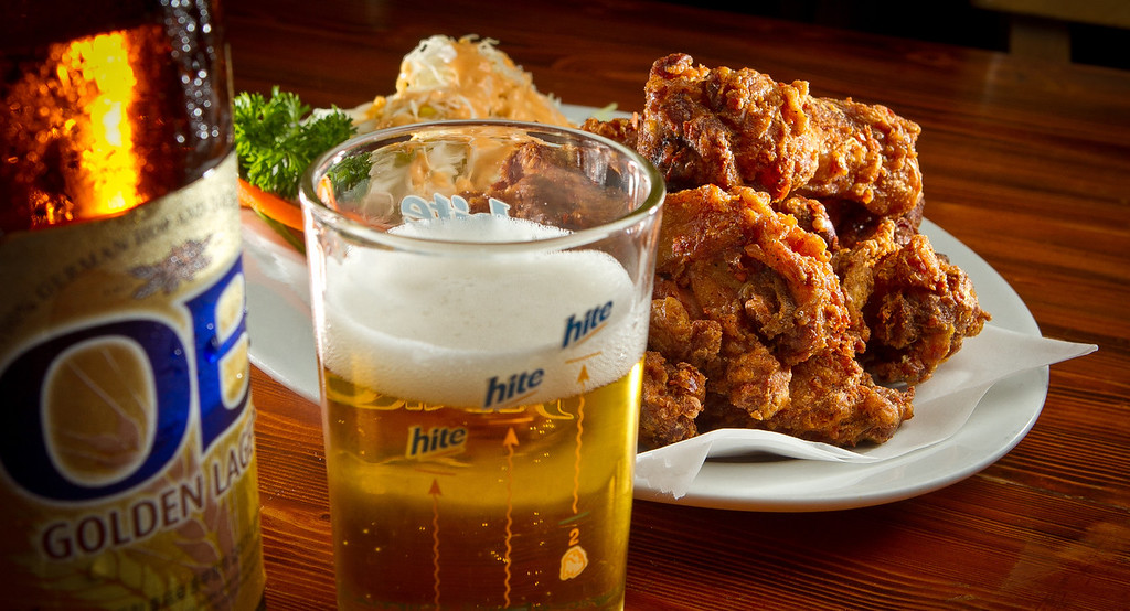 The Chicken Wings with a Korean Beer at Toyose restaurant in San Francisco, Calif., is seen on Wednesday, July 17th, 2012.