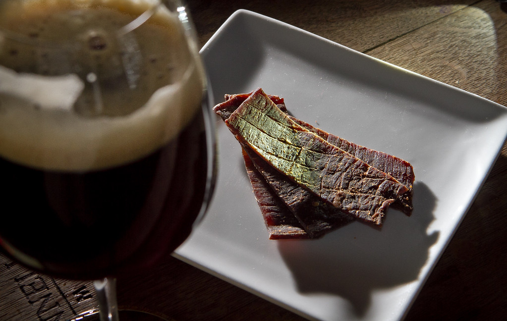 The Oaktown Jerky with a beer at Trappist Bar in Oakland, Calif.,  is seen on Tuesday, December 20th,  2011.