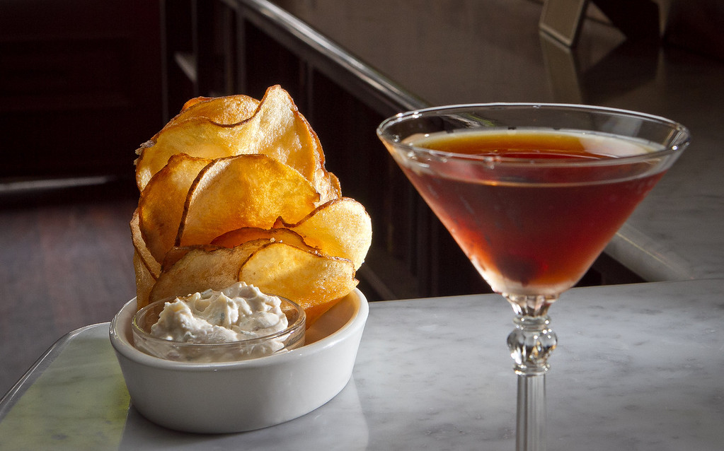 "The ""Two Sisters"" cocktail with Potato Chips and Dip at Two Sisters Bar & Books in San Francisco, Calif., are seen on Saturday,  August 25th, 2012."