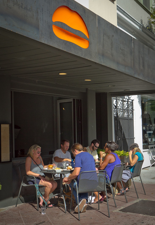 Diners enjoy lunch outside at Umami Burger in San Francisco, Calif., on Wednesday,  October 12, 2011.