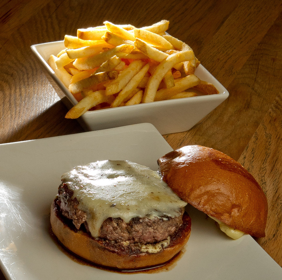 "The ""Truffle"" burger with fries at Umami Burger in San Francisco, Calif., is seen on Sunday, January 8th,  2012."