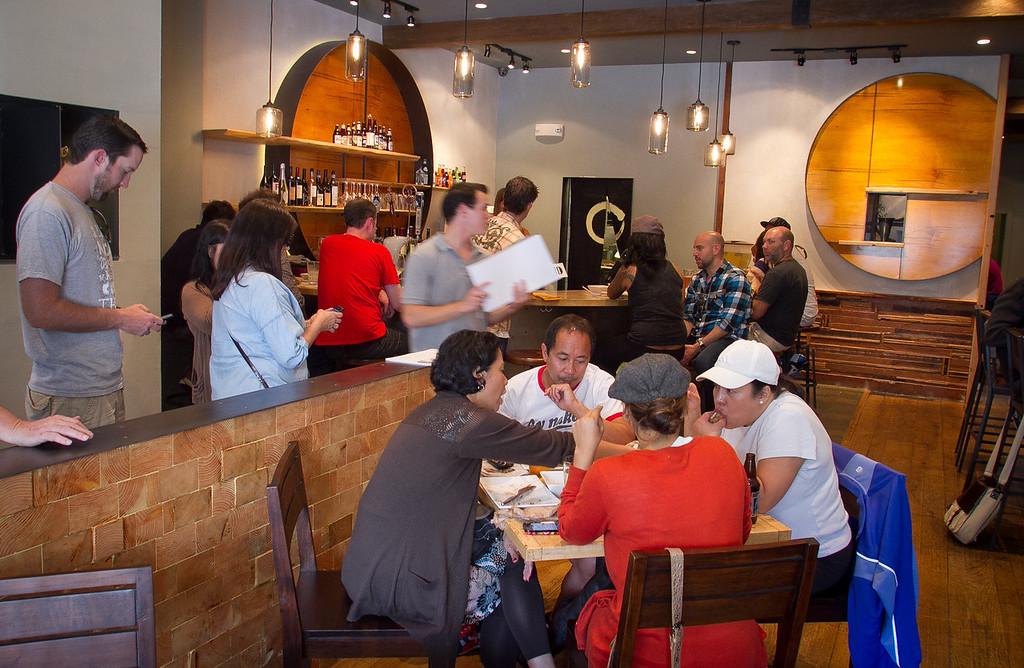 Diners enjoy lunch at Umami Burger in San Francisco, Calif., on Wednesday,  October 12, 2011.
