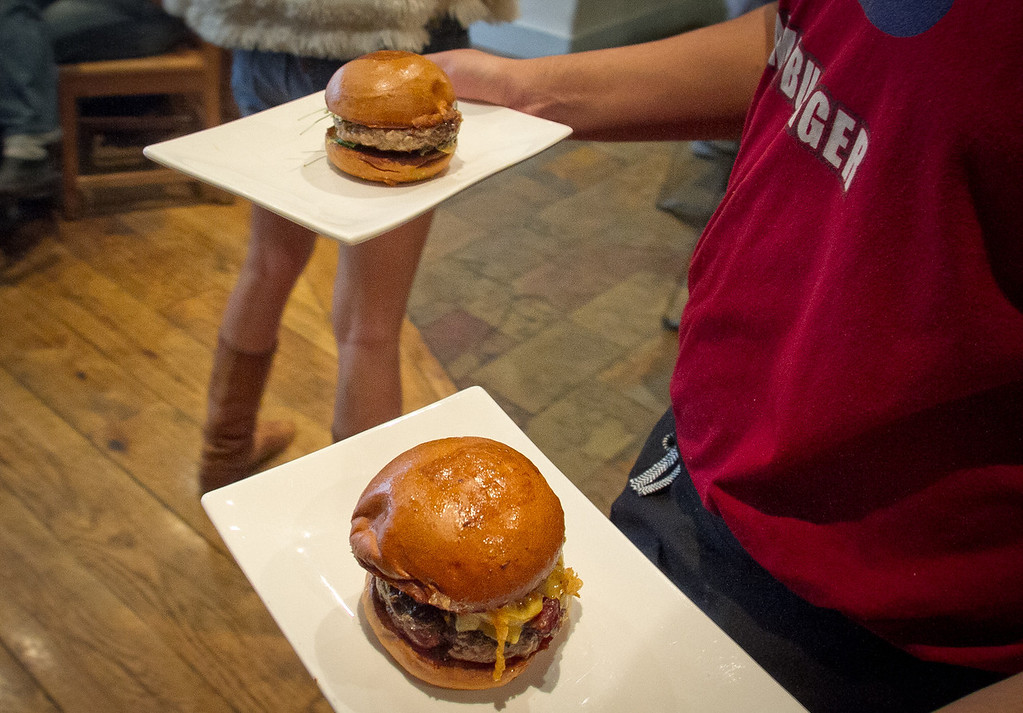 Burgers being brought out from the kitchen at Umami Burger in San Francisco, Calif., on Sunday, January 8th,  2012.