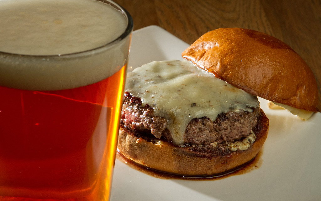 "The ""Truffle"" burger with a beer at Umami Burger in San Francisco, Calif., is seen on Sunday, January 8th,  2012."