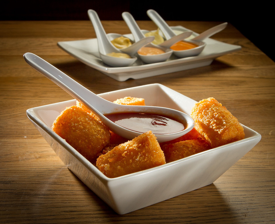 The Cheese Tots with condiments at Umami Burger in San Francisco, Calif., are seen on Sunday, January 8th,  2012.