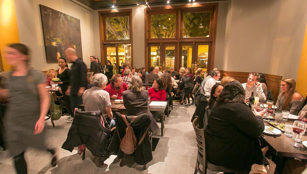 Diners enjoy dinner at Vesta restaurant in Redwood City, Calif. on Wednesday, December 19th, 2012.