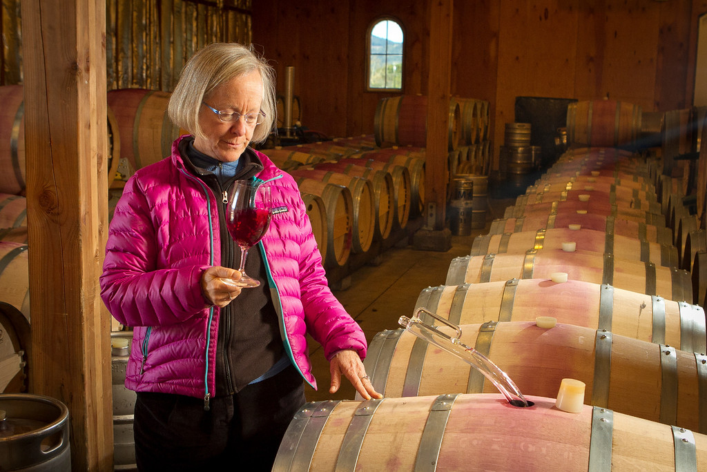 Winemaker Cathy Corison smells the 2011 Cabernet in the barrel at her winery in St. Helena, Calif., on Friday, December 16, 2011.