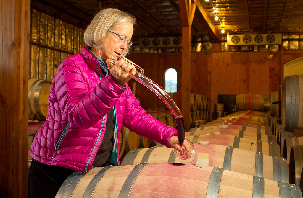 Winemaker Cathy Corison pulls a sample of  the 2011 Cabernet in the barrel at her winery in St. Helena, Calif., on Friday, December 16, 2011.