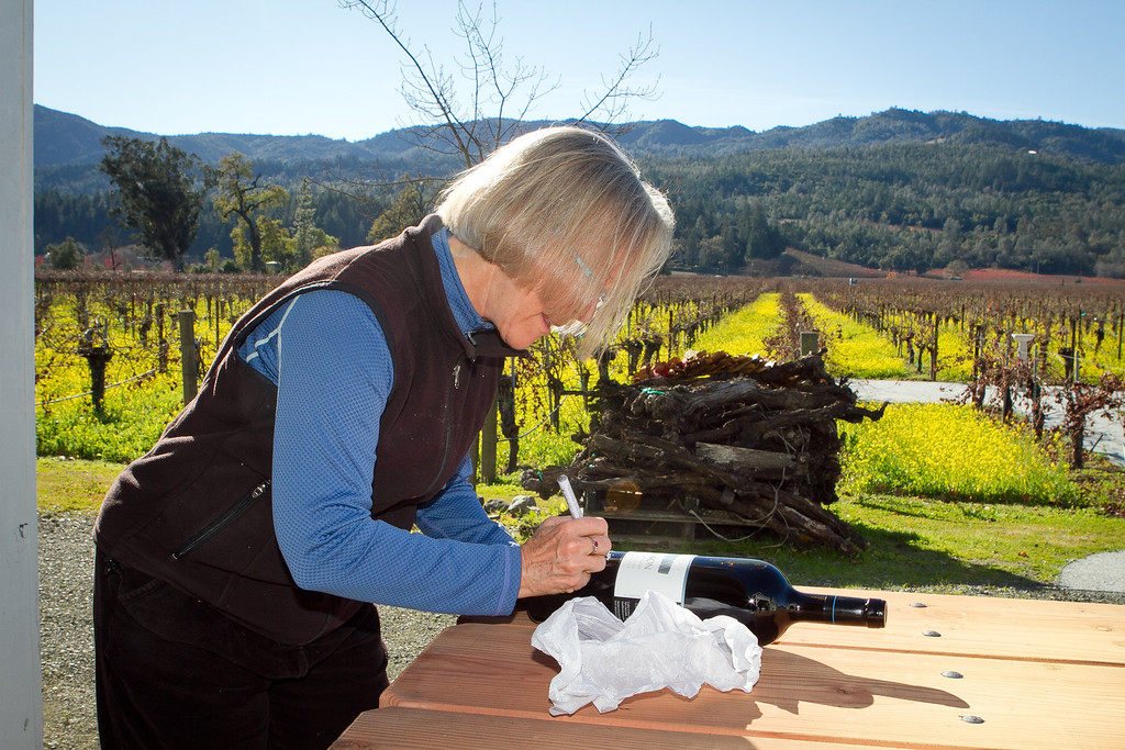 Winemaker Cathy Corison signs a magnum of Cabernet for a wine club member at her winery in St. Helena, Calif., on Friday, December 16, 2011.